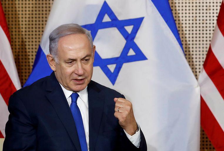 De Israëlische premier Benjamin Netanyahu tijdens de persconferentie in Polen. Beeld REUTERS