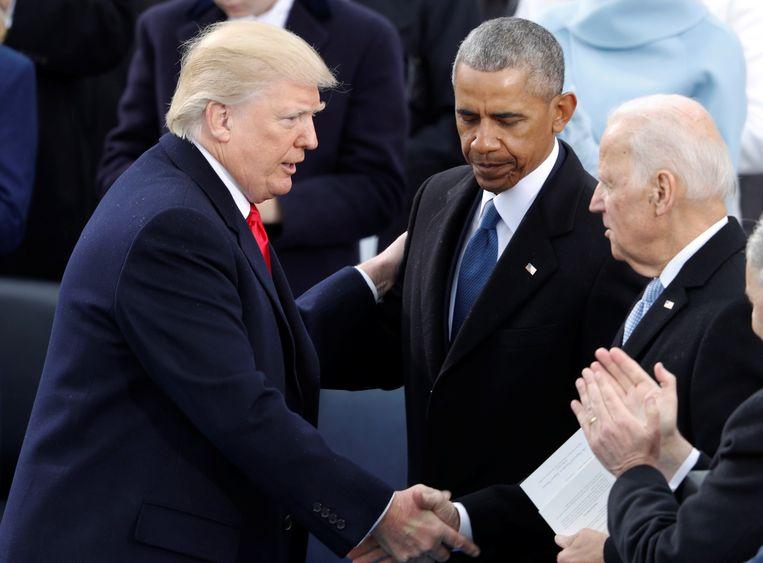 President Donald Trump, zijn voorganger Barack Obama en Joe Biden bij Trumps aantreden als president in 2017. Beeld REUTERS