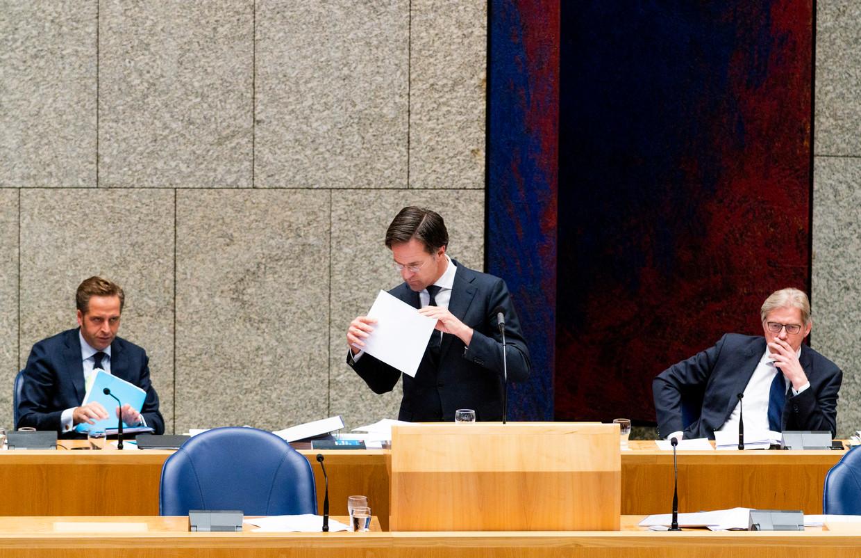 Minister Hugo de Jonge, premier Mark Rutte en minister Martin van Rijn tijdens een Kamerdebat over de coronacrisis, 7 mei.  Beeld Freek van den Bergh / de Volkskrant