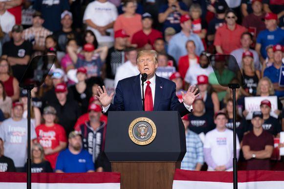 De Amerikaanse president Trump tijdens een verkiezingsrally in Manchester, New Hampshire.