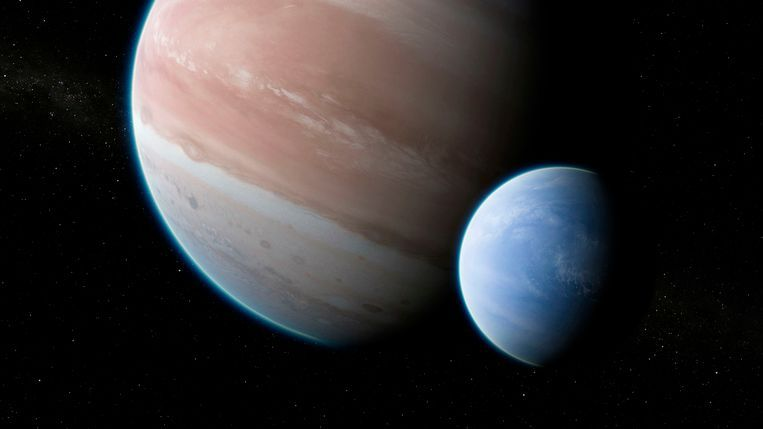 Een illustratie van exoplaneet Kepler 1625b, met zijn maan. Beeld AP