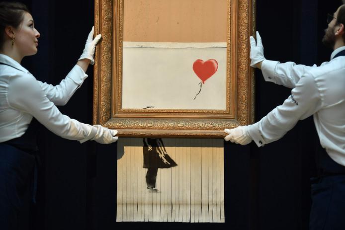 Het halfversnipperde kunstwerk van Banksy.