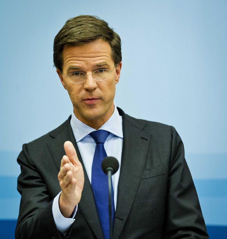 Premier Rutte bij zijn wekelijkse persconferentie in perscentrum Nieuwspoort. Beeld anp
