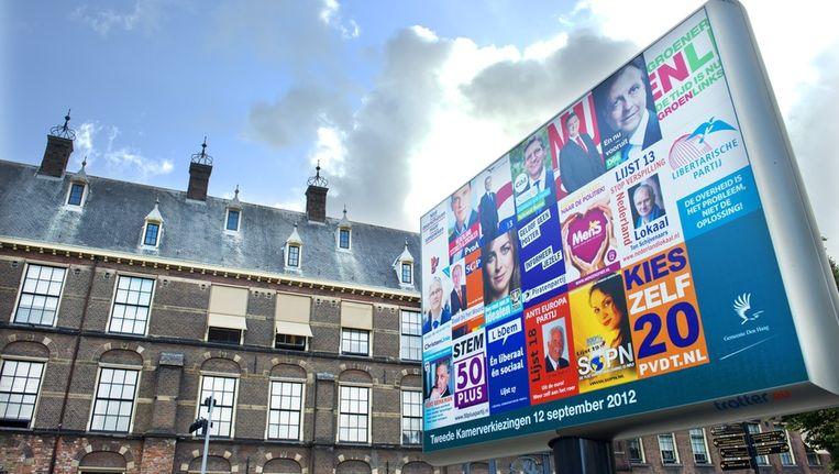 Een verkiezingsbord voor het Binnenhof, het hart van de Nederlandse democratie. Beeld anp