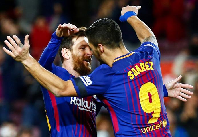 Luis Suarez (rechts) en Lionel Messi