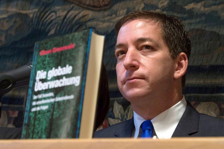 Glenn Greenwald oogt vermoeid tijdens de persconferentie op December 1, 2014 in Münschen, Duitsland Beeld afp