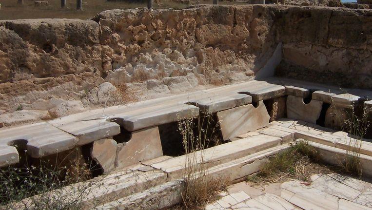 Romeinse wc's bij Leptis Magna in wat nu Libië is. Beeld Craig Taylor