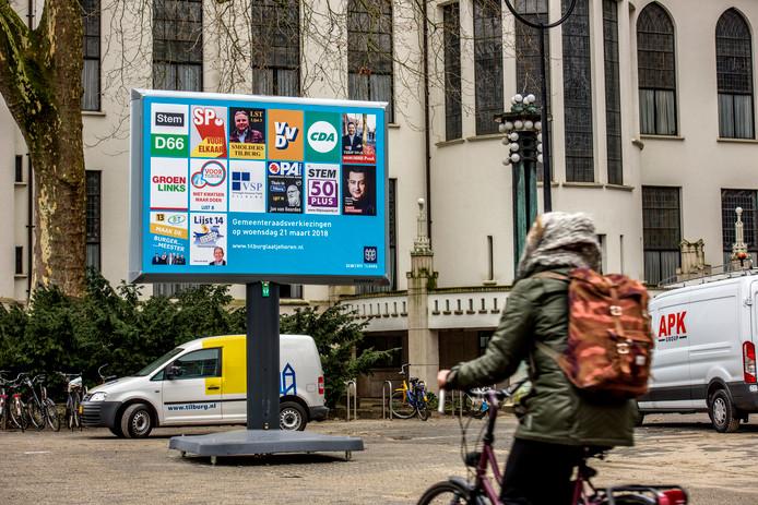 Een verkiezingsbord in Tilburg, met daarop ook de slogan van Voor Tilburg.
