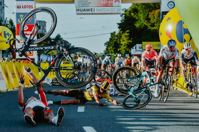 Dutch cyclist Dylan Groenewegen (on the ground ,C) and fellow riders collide during the opening stage of the Tour of Poland race in Katowice , southern Poland on August 5, 2020. - Dutch rider Fabio Jakobsen was fighting for his life on Wednesday after he was thrown into and over a barrier at 80km/h in a sickening conclusion to the opening stage of the Tour of Poland. (Photo by Szymon Gruchalski / Forum / AFP)