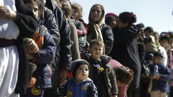 Illustratiebeeld. Vrouwen en kinderen vluchten voor het geweld van IS.