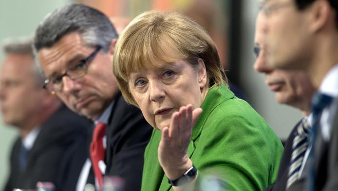Ulrich Grillo (à gauche) avec la Chancelière allemande Angela Merkel (7 mars 2013)
