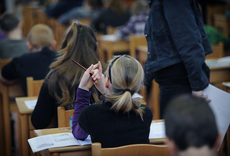 Groep 8 maakt de Cito-toets op basisschool Mgr. Zwijsenschool. Beeld null