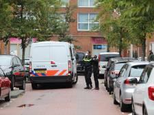 Politie houdt drie personen aan in woning Graskopstraat Den Haag
