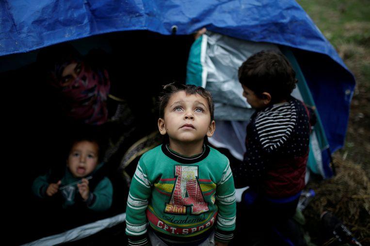 Vluchtelingen op het eiland Lesbos wachten vertwijfelend op wat komen gaat