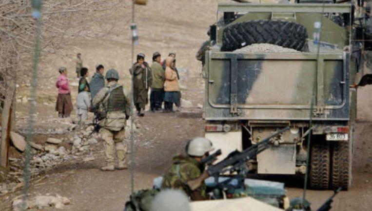 Een Nederlandse ISAF-eenheid op patrouille in de buurt van Tarin Kowt in Uruzgan. Foto: anp Beeld