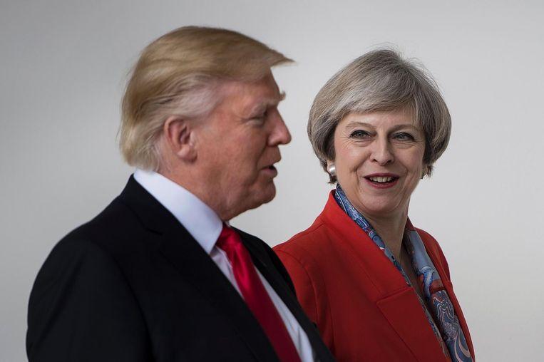 Donald Trump en Theresa May. Beeld null