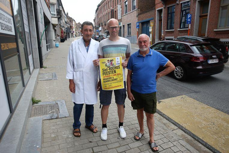 Marcel Ghysels van slagerij Sampoux, Kim Barbé van Maspoe en Claude Soutaer van Drukal op de Sint-Rochusstraat.