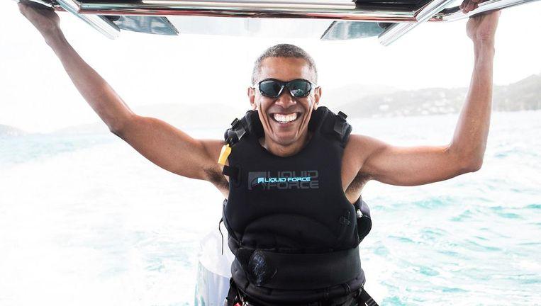 Obama op een boot met de Britse miljardair Richard Branson. Beeld reuters