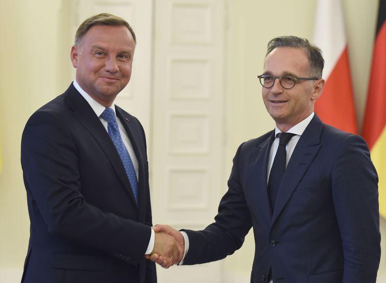 De Duitse minister van Buitenlandse Zaken Heiko Maas (rechts) liet vrijdag weten dat de standpunten over een Europese missie uiteen liepen.  Beeld AFP