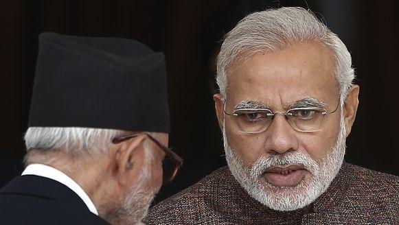Narendra Modi, de nieuwe premier van India (R).