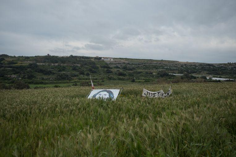 De plek waar Caruana Galizia's auto ontplofte, vlakbij haar huis in Bidnija. Beeld Joanna Demarco