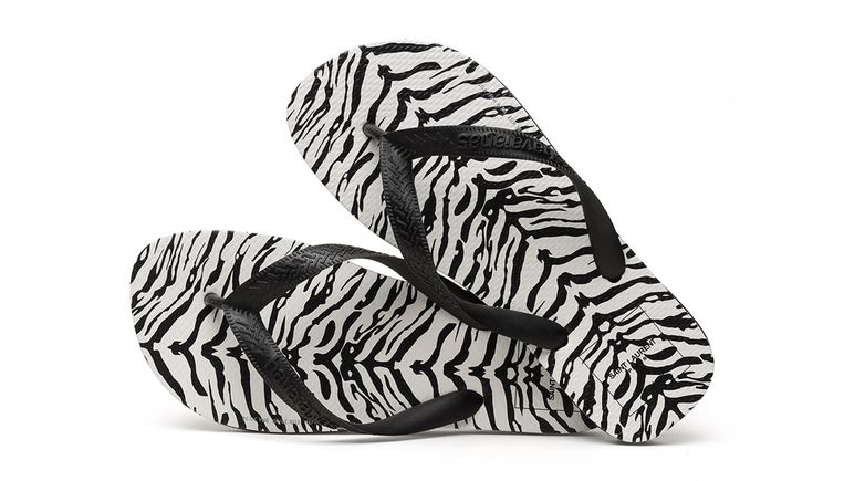 De slippers van Saint Laurent en Havaianas