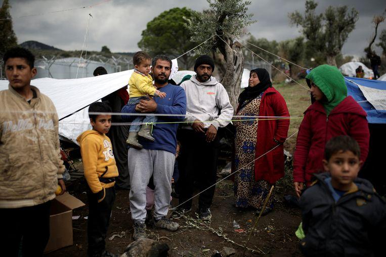 Een Syrische familie op het Griekse eiland Lesbos. Beeld REUTERS