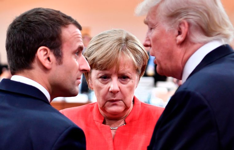 Franse President Macron, bondskanselier Merkel en President Trump vorig jaar tijdens de G20 in Hamburg. Beeld ANP