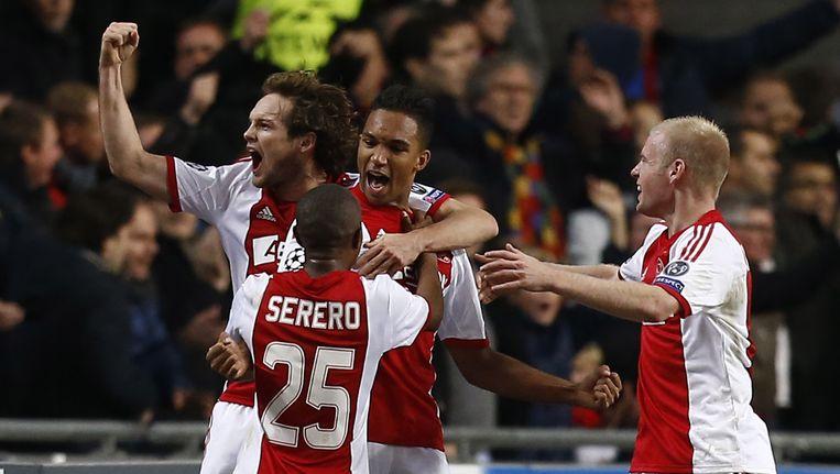 Ajax juicht in de wedstrijd tegen FC Barcelona, in de Champions League vorig jaar. Beeld anp