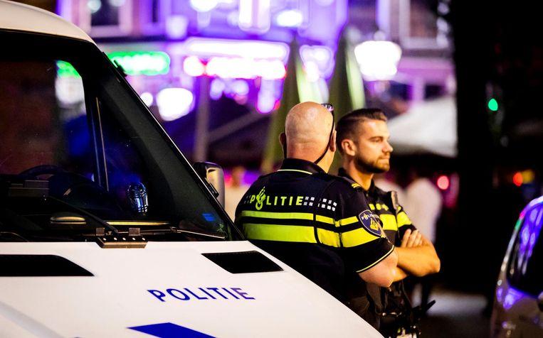 Politieagenten in Amsterdam. Beeld ANP