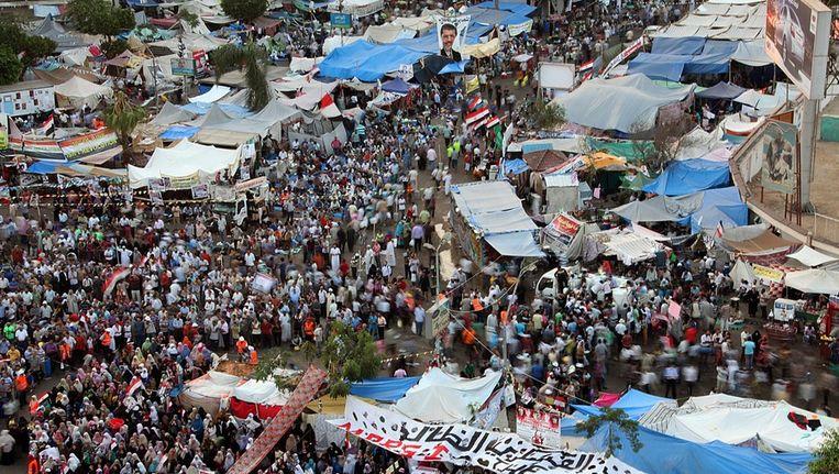 Supporters van de Moslim Broederschap nabij de Rabaa al-Adawiya moskee. Beeld epa