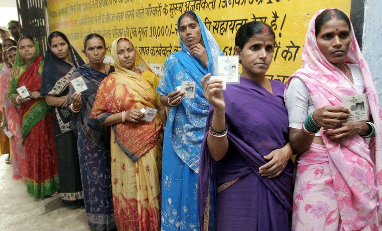 Arme vrouwen in saree. Beeld AFP