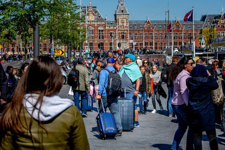 Drukte nabij het Amsterdamse Centraal Station, in 2018.  Beeld ANP