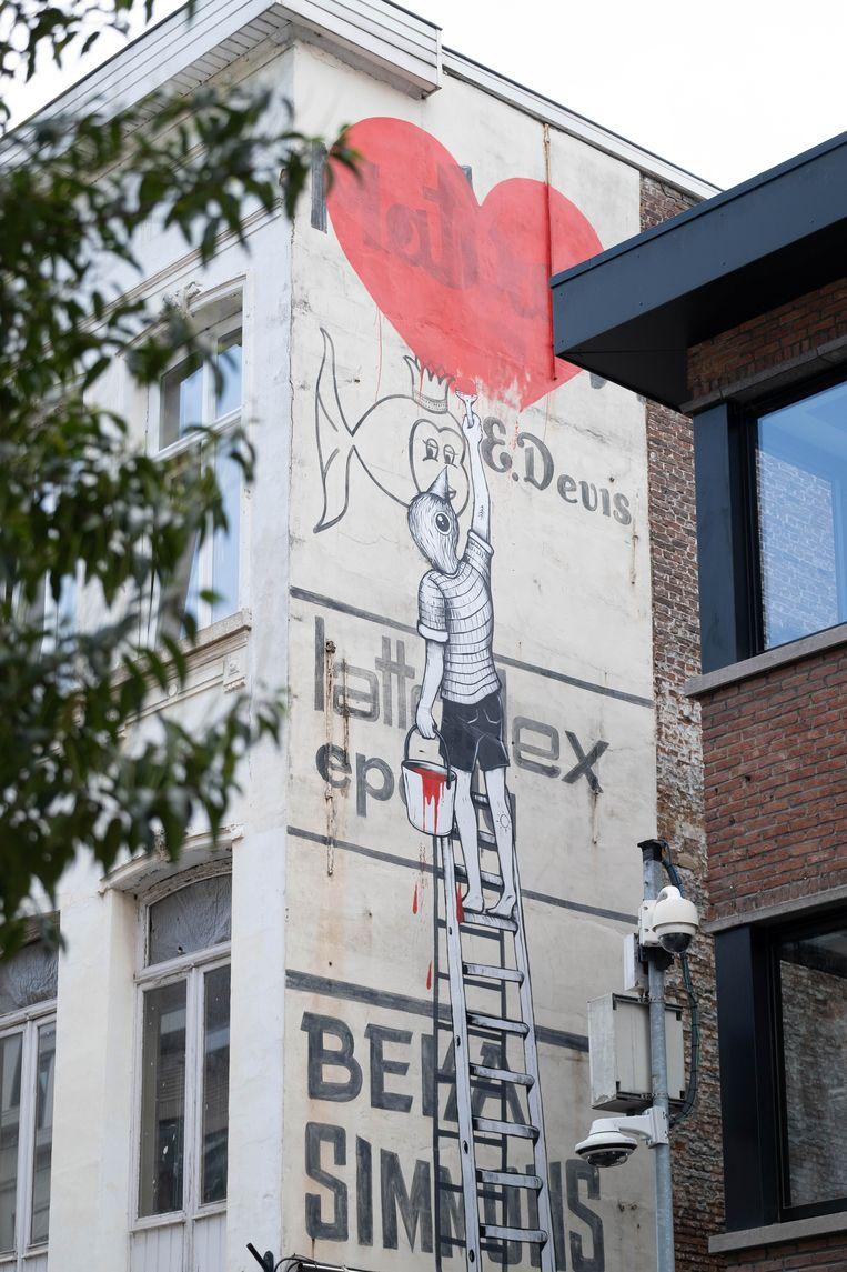 Street art in de autoluwe Onze-Lieve-Vrouwestraat te Mechelen door Gijs Vanhee.