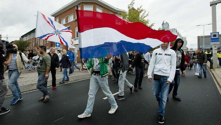 Pro Patria demonstranten tijdens de Mars voor de Vrijheid op 10 augustus in Den Haag. Beeld epa