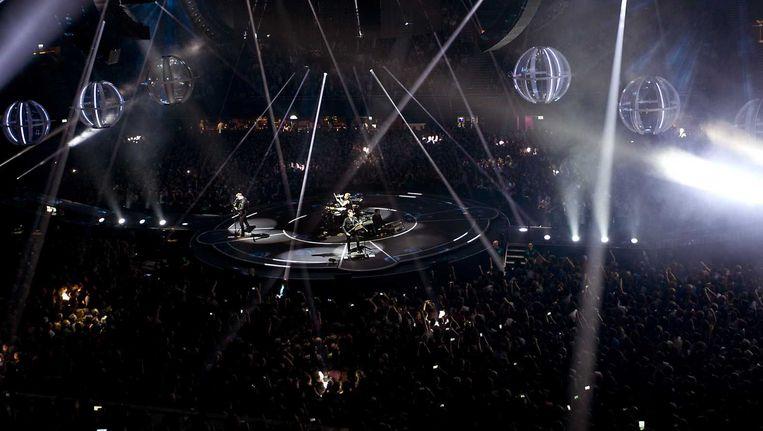 De Britse rockband Muse trad deze week op in de Amsterdamse Ziggo Dome, omringd door 'state-of-the-art podiumtechniek'. Volgens gedupeerde podiumbouwers worden dit soort decors neergezet onder bedenkelijke arbeidsomstandigheden. Beeld null