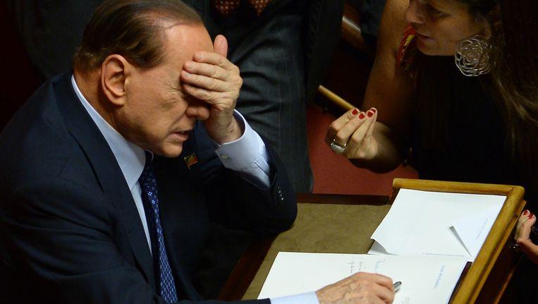 Justitie in Milaan heeft donderdag een nieuw onderzoek naar Silvio Berlusconi aangekondigd. Beeld AFP