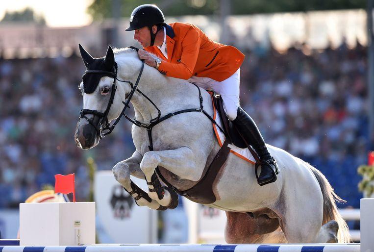 Jur Vrieling is professioneel springruiter én paardenhandelaar, een veelvoorkomende combinatie. Beeld EPA