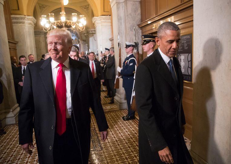 Donald Trump en Barack Obama in het Capitool in Washington, 2017. Beeld AP