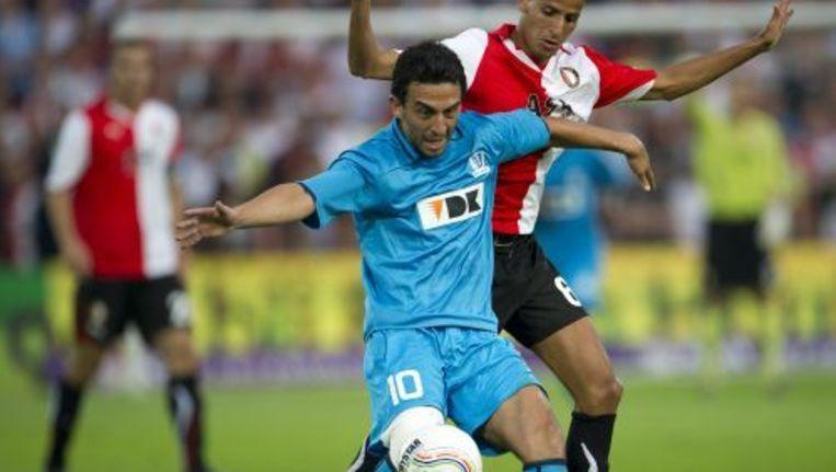 Randall Azofeifa (L) van AA Gent in duel met Karim el Ahmadi van Feyenoord. Vanavond is de return. Foto ANP Beeld