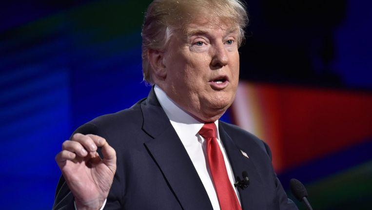 Donald Trump tijdens het Republikeinse kandidatendebat afgelopen maart in Miami Beeld epa