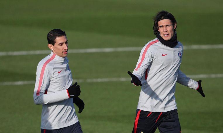 Angel Di Maria en Edinson Cavani trainen voor de wedstrijd van Paris St Germain tegen FC Barcelona in de Champions League Beeld null