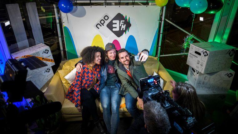 3FM-dj's Angelique Houtveen, Sander Hoogendoorn en Domien Verschuuren. Beeld anp