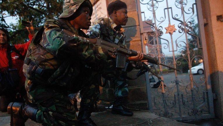 Veiligheidstroepen maken zich klaar voor actie Beeld ANP
