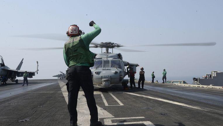 Het Amerikaanse vliegdekschip USS George H.W. Bush in de Perzische Golf. Beeld epa