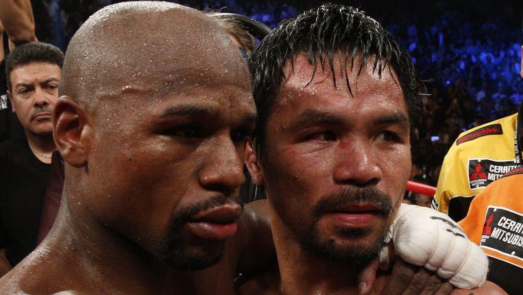 Floyd Mayweather Jr. en Manny Pacquiao, de twee bestbetaalde boksers ter wereld Beeld anp