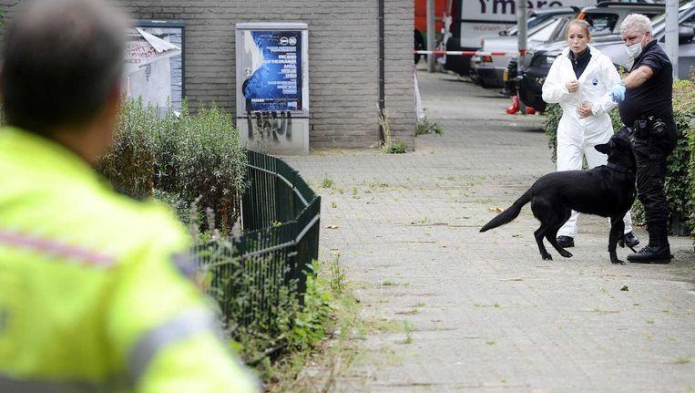 Politieonderzoek op de plaats delict in de Conradstraat Beeld anp