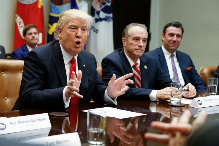 President Trump komt maar niet aan regeren toe.  Beeld AP