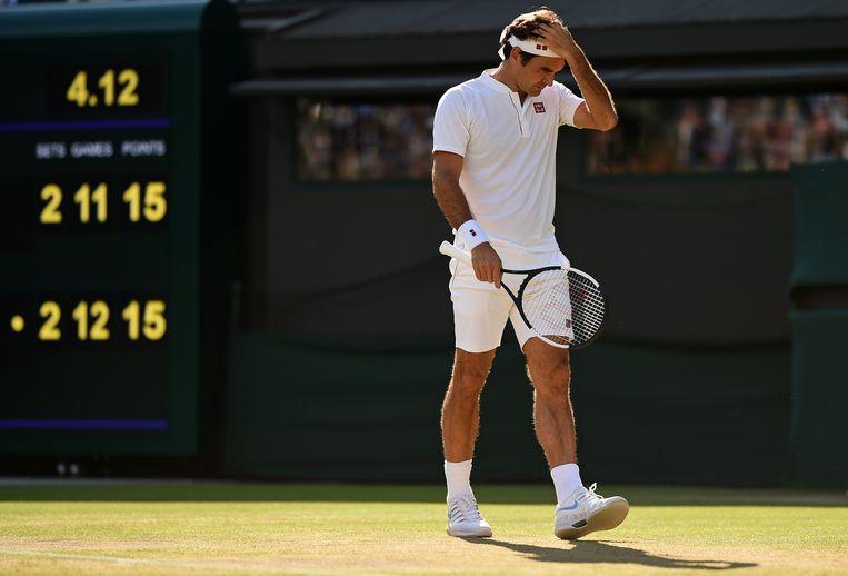 Roger Federer in de kwartfinalewedstrijd tegen Kevin Anderson. Beeld AFP