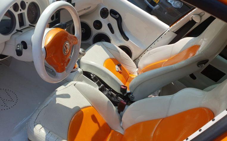 De elektrisch te bedienen stoelen zijn van Porsche.